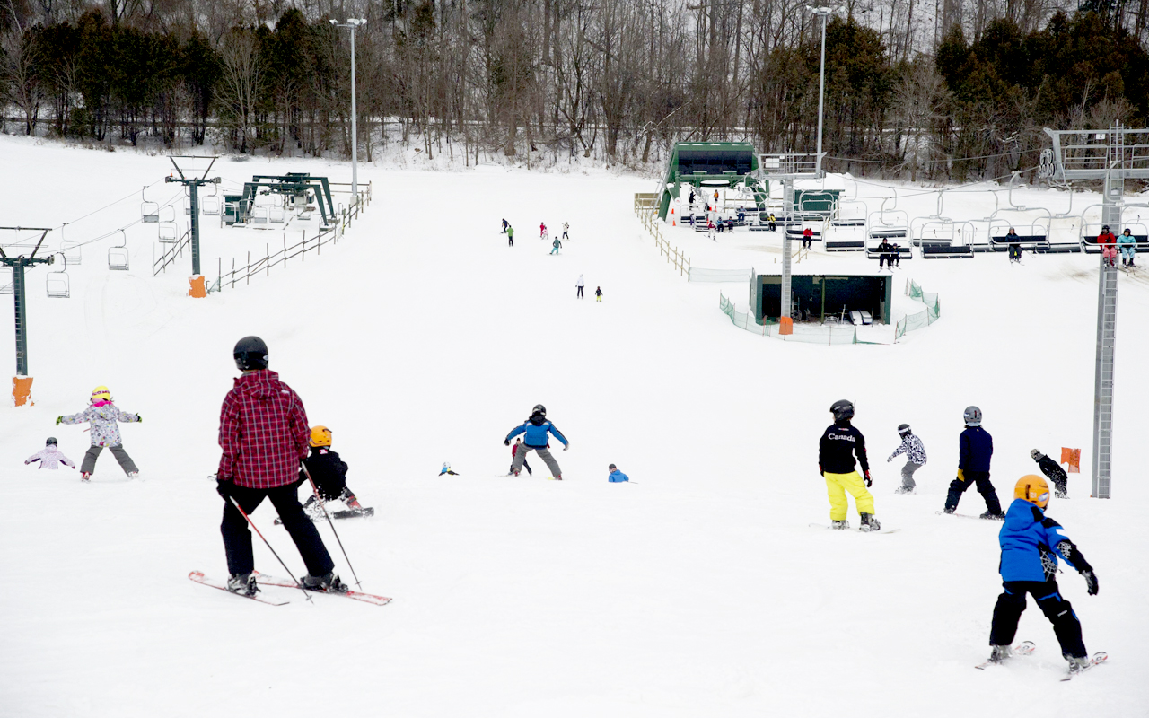 13176baabb7d Young skiers skiing between the ski lift at the Earl Bales Ski and Snowboard  Centre