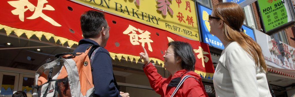 Visitors enjoying Toronto's chinatown with a Toronto Greeter