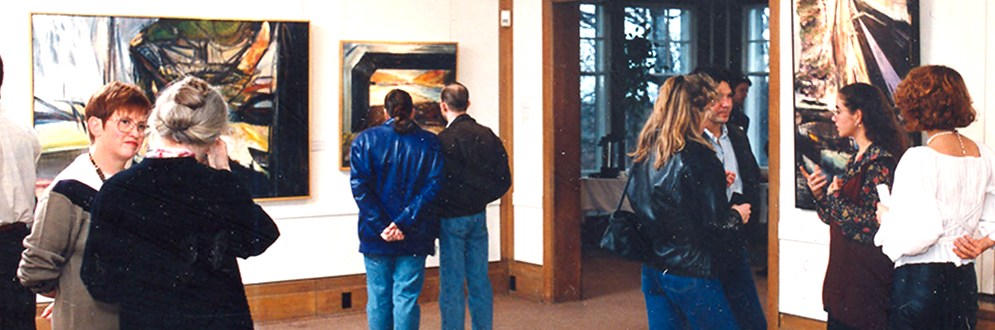 Visitors view art work in the Cedar Ridge Gallery.