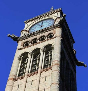 Toronto Old City Hall clock tower strikes 11:00 a.m. on Remembrance Day