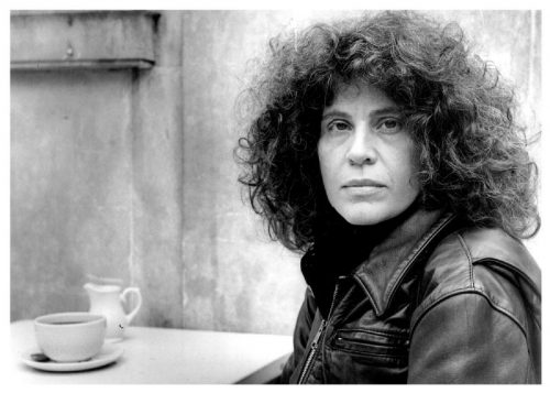 black and white photo of Anne Michaels with coffee cup and saucer in background