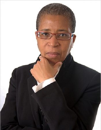 Headshot of Dionne brand holding her hand beneath her chin