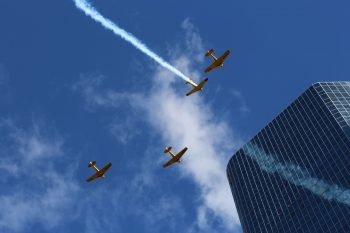 Remembrance Day fly past in missing man formation - four WW2 aircraft flying over downtown Toronto