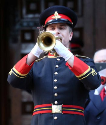 Bugler plays the last post during Remembrance Day ceremonies at Toronto's Old City Hall