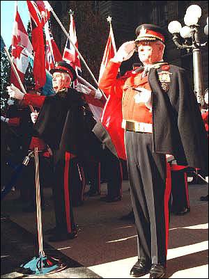 Toronto Honour Guard member salutes the flag