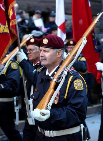 Remembrance Day Ceremony, Toronto Fire Fighter Honour Guard participant marching in parade