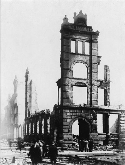 A four-storey section of a wall above the Bay Street entrance to the Wyld-Darling building remains after the fire. The rest of the upper-storey walls are gone.