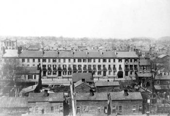 A line of row houses from left to right, with columned Osgoode Hall in upper left