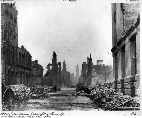 The facades of some of the buildings are still standing, but many are half-fallen or gone. Bay Street is filled with rubble.