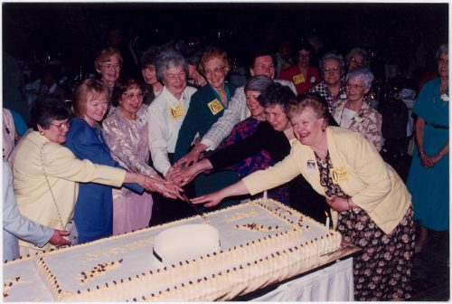 Alumnae Association past-presidents cutting 100th anniversary cake