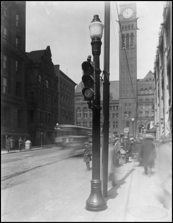Lamp post with traffic lights attached. Old City Hall is in the background.