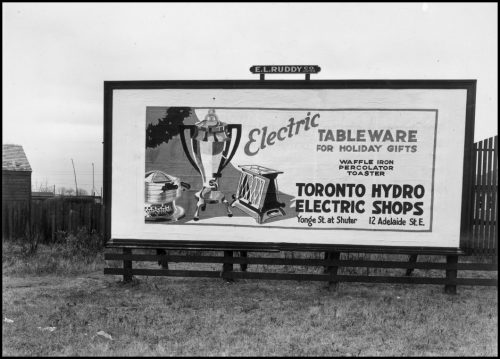 Billboard ad showing electric coffee maker, waffle iron and toaster.