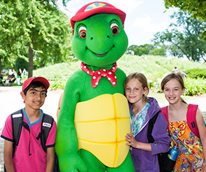 Children posing with Franklin the Turtle