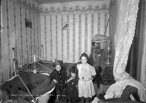 Children in a crowded, cluttered room