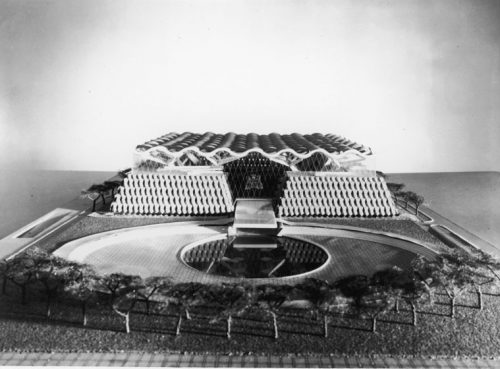 Model of short building with two quadrilateral sections joined by a wave-shaped roof