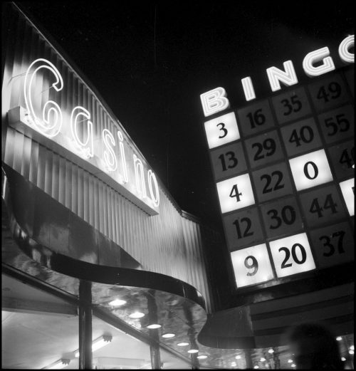 Neon signs saying Casino and Bingo. One looks like a bingo card.