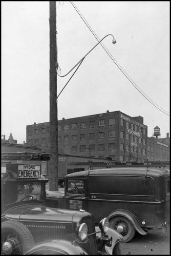 Cars parked near a street light