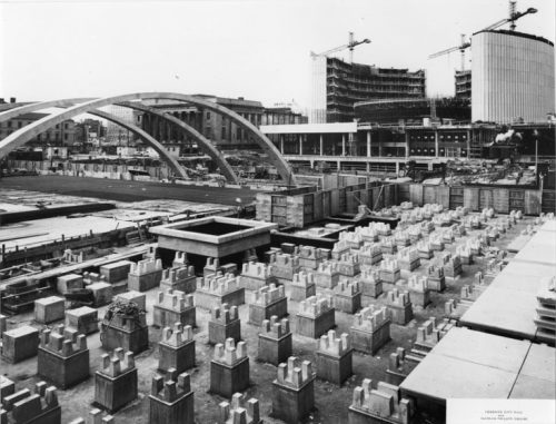 Nathan Phillips Square and reflecting pool under construction showing pillars for underground parking garage