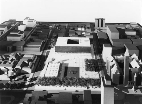 Model of large square building with hole in centre
