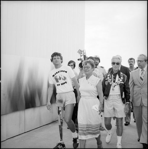A picture of Terry Fox walking with Alderman Eidt and Mayor Harris