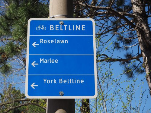 Photograph of a large wayfinding sign directing cyclists to nearby roads and trails