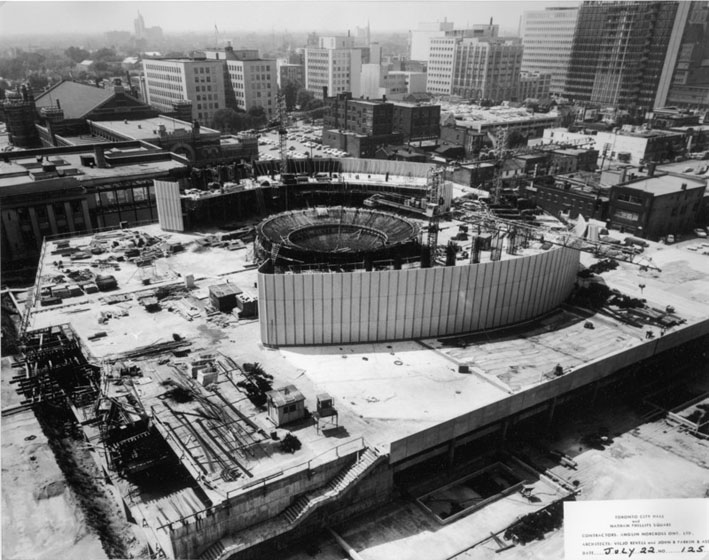 City Hall under construction seen from the air, with only a few storeys and part of the central rotunda built
