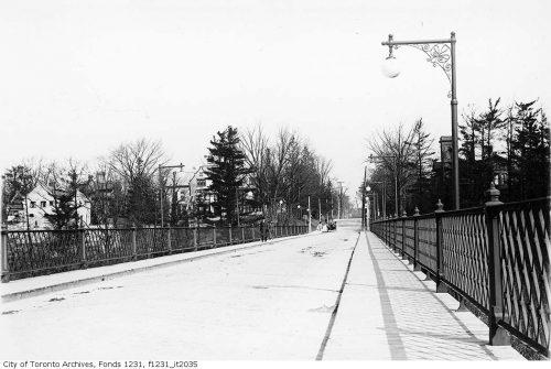 Bridge with decorative metal railings and lamppost.