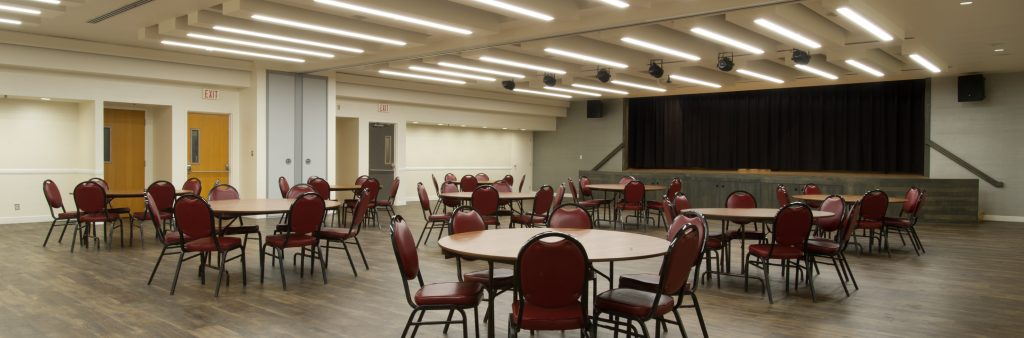 Memorial Hall Burgundy Room with a round tables setup throughout the room