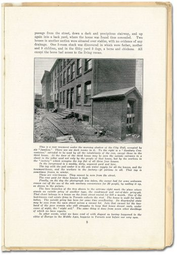 Page of a book with a photograph of a three-storey brick building and shed.
