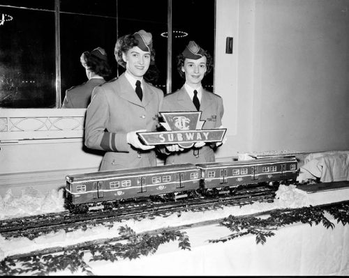 TTC employees with subway cake
