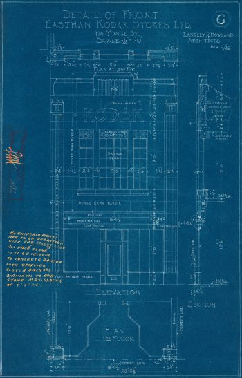 "Blueprint of two-storey building with tall windows on the second floor and a sign reading ""Kodak""."