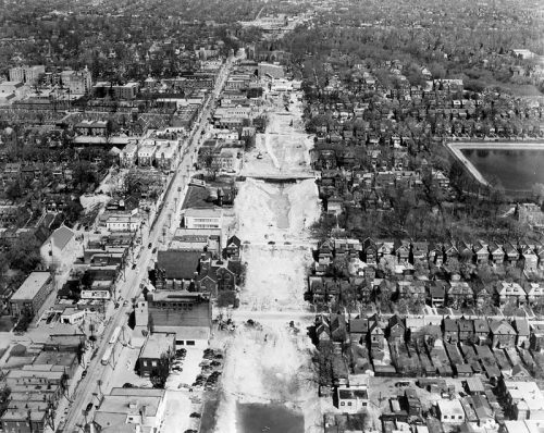 Aerial photo showing trench dug for subway, Yonge Street business area on one side, houses on the other