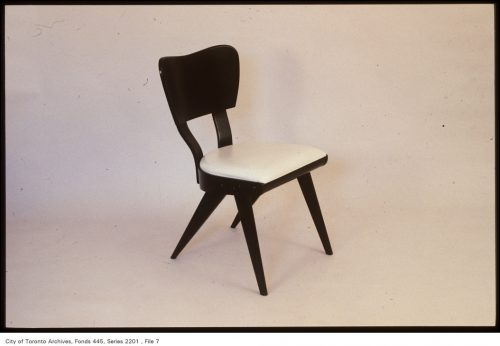 Daark wood chair with white padded seat.