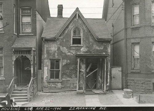 Old broken-down house with broken door, falling plaster
