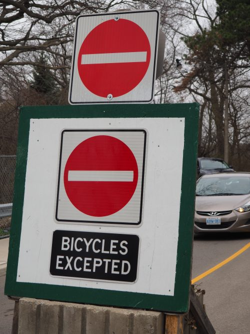 Bicycles excepted sign. Noting that vehicles cannot go forward but there is a contraflow lane for cyclists.