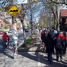 Image of pedestrians on a sidewalk