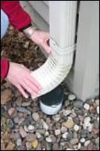Inserting the downspout elbow to the bottom of the downspout.
