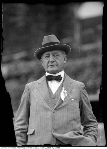Man in striped suit, bow tie, and hat.