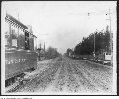 streetcar on tracks on a dirt road