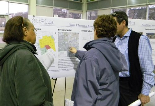 People pointing to a map during the March 2017 Open House portion of the Keele Finch Plus March 2017 meeting.