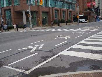 Cycle track chevrons show cyclists and drivers the route cyclists should take through the intersection