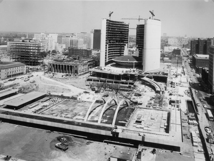 City Hall and Nathan Phillips Square under construction as seen from the air from the south, towers mostly completed