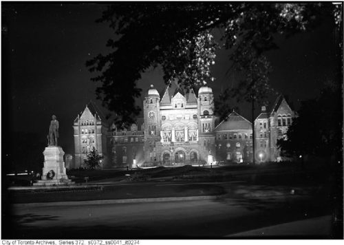 Queen's Park buildings lit up by spotlights.