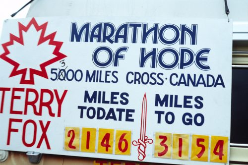 Picture of Terry Fox Marathon of Hope banner stating how many miles he ran (2146) and how far he has to go (3154)