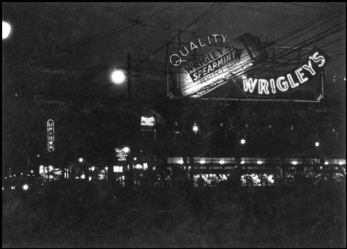 Illuminated sign advertising Wrigley's gum.