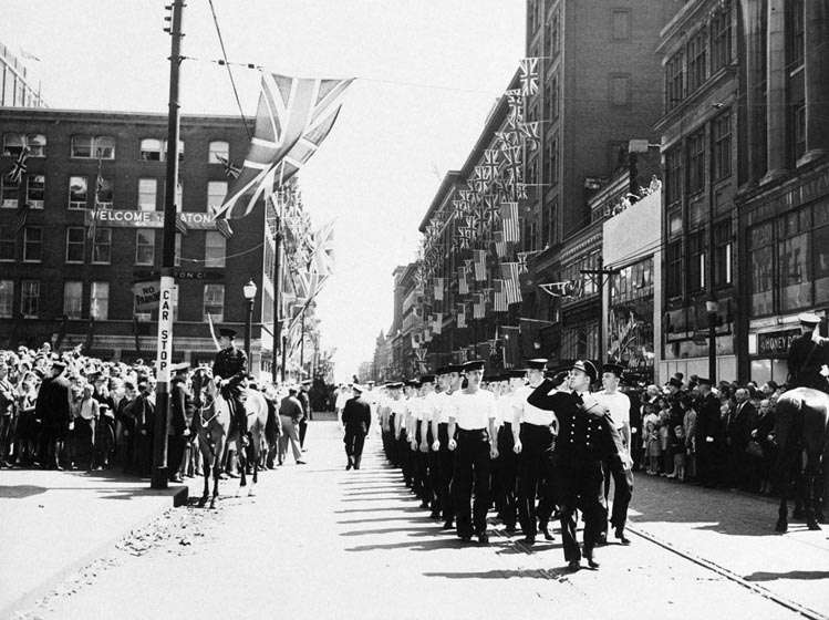 Sailors march in formation along Queen Street.