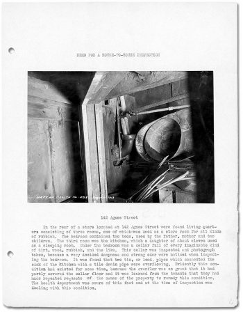 Book page that includes photograph of pipes and garbage in a basement.