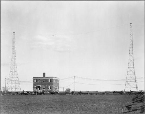 Radio transmitters next to brick building