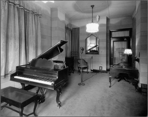 Piano and microphone in recording room, King Edward Hotel