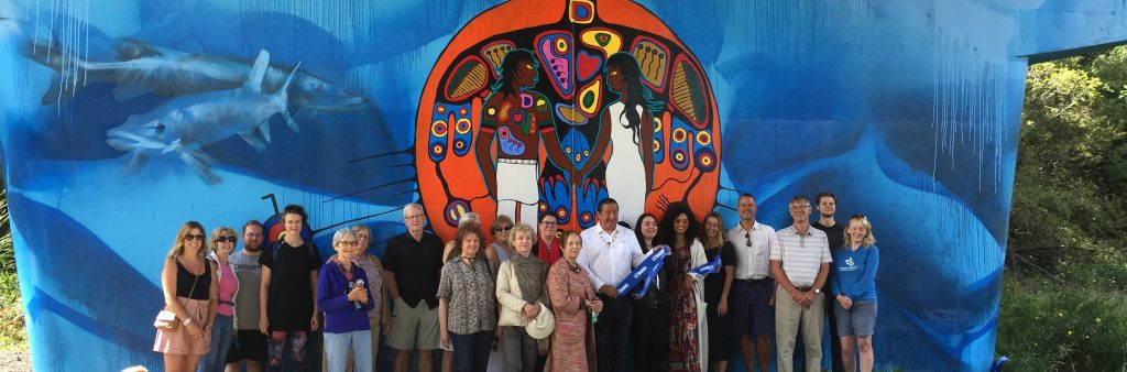 community gathered to celebrate mural